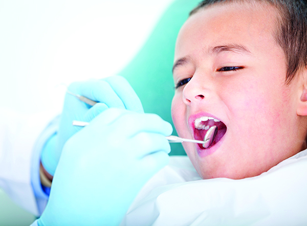Boy visiting the dentist for cleaning and checkup
